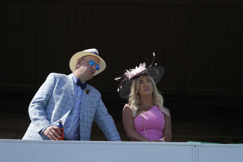 Fans watch a race before the 147th running of the Kentucky Derby at Churchill Downs, Saturday, May 1, 2021, in Louisville, Ky. (AP Photo/Brynn Anderson)