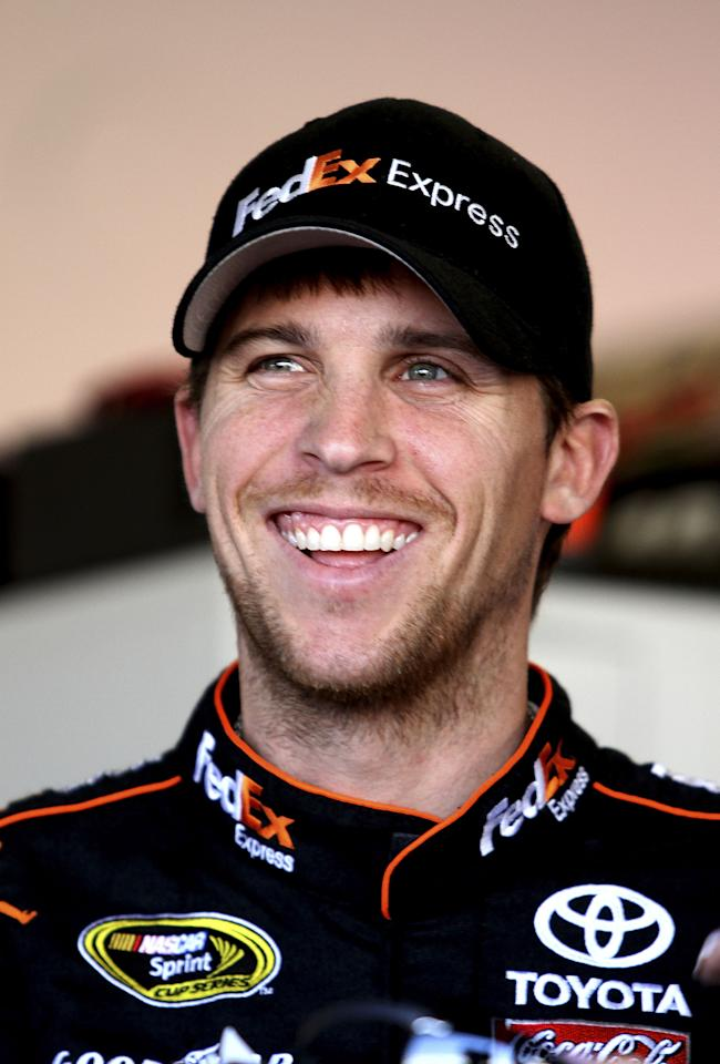 DAYTONA BEACH, FL - JANUARY 12:  Denny Hamlin, driver of the #11 FedEx Toyota during Daytona Preseason Thunder at Daytona International Speedway on January 12, 2012 in Daytona Beach, Florida.  (Photo by Jerry Markland/Getty Images for NASCAR)