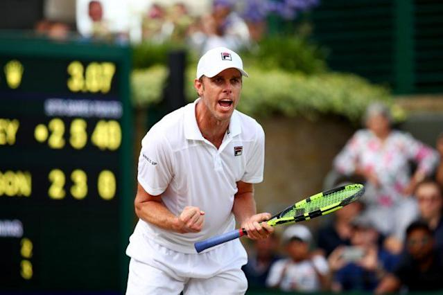 """Sam Querrey shouts for joy after a five-set win over <a class=""""link rapid-noclick-resp"""" href=""""/ncaaf/players/226708/"""" data-ylk=""""slk:Kevin Anderson"""">Kevin Anderson</a>. (Getty)"""