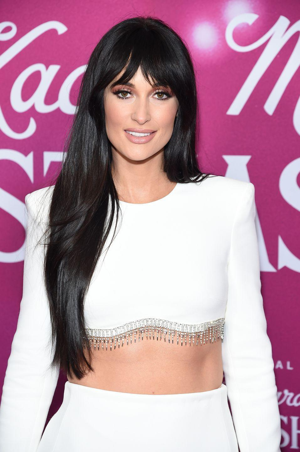 <p>As Kacey Musgraves demonstrates, sometimes choppy fringe is the perfect accent to long, shiny strands. </p>