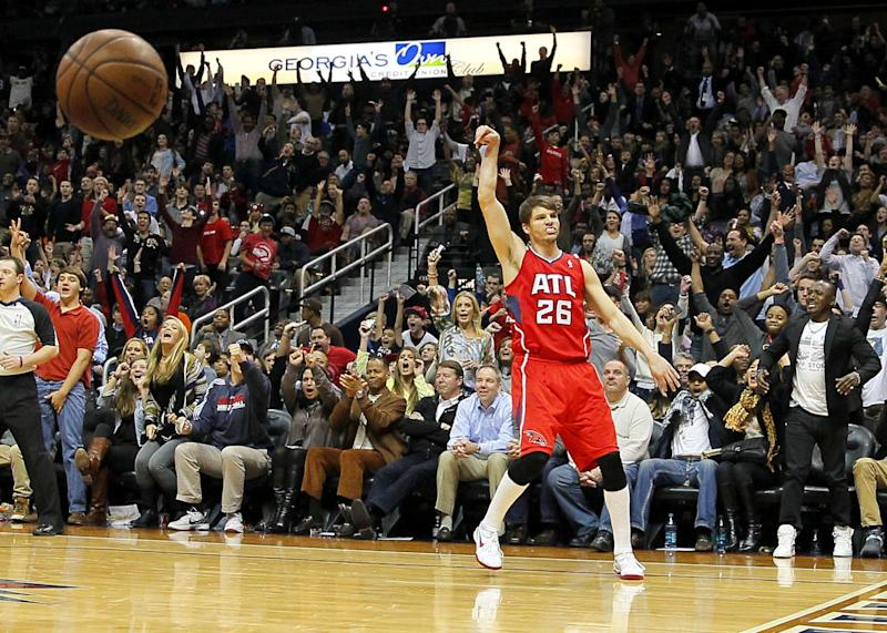 Atlanta Hawks shooting guard Kyle Korver (26) reacts after sinking a 3-pointer late in the fourth period during an NBA basketball game against the Miami Heat in Atlanta, Monday, Jan. 20, 2014. The Hawks won the game 121-114. (AP Photo/Todd Kirkland)