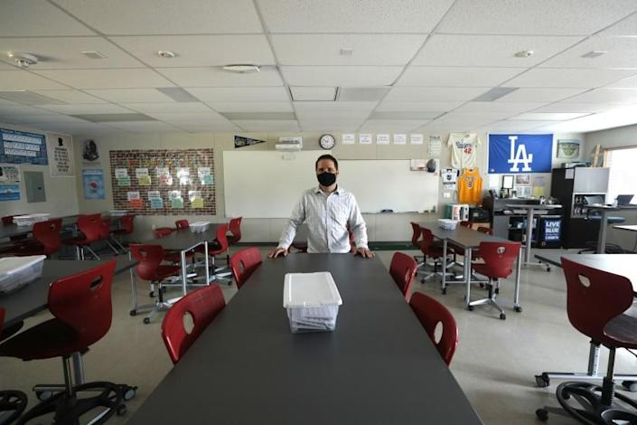 "Sean Brandlin, an eighth grade social studies teacher at El Segundo Middle School, stands in his classroom. <span class=""copyright"">(Los Angeles Times)</span>"