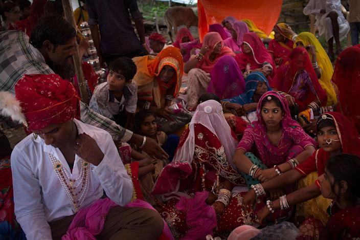 <p>A wedding takes place in a small village near Udaipur, Rajasthan, India in July 2016. The groom says to be 18 years old and the bride 22. A relative says later she is younger than him. Some families lie about the age of the woman because they are afraid of the government's actions. Some of these girls do not have a birth certificate, so it is easier for the families to get away with it. (Photo: Rafael Fabrés) </p>