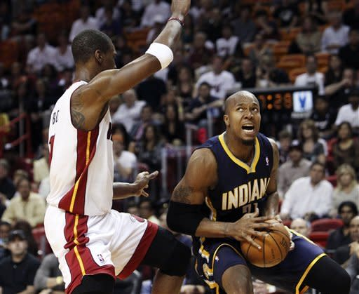 Miami Heat's Chris Bosh (1) blocks Indiana Pacers' David West (21) during the first half of an NBA basketball game in Miami, Saturday, March 10, 2012. (AP Photo/J Pat Carter)