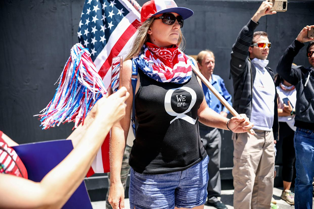 Conspiracy theorist QAnon demonstrators protest during a rally to re-open California and against Stay-At-Home directives on May 1, in San Diego, California.