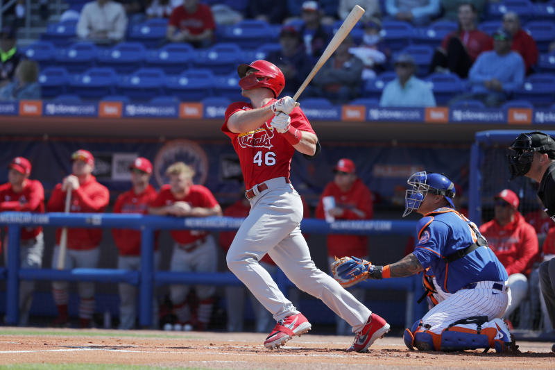 St. Louis Cardinals' Paul Goldschmidt (46) follows through on a solo home run during the first inning of a spring training baseball game against the New York Mets Friday, Feb. 28, 2020, in Port St. Lucie, Fla. (AP Photo/Jeff Roberson)