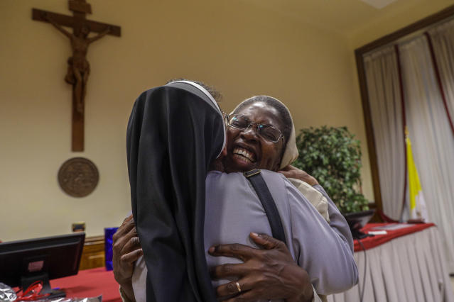 Togolese Sister Makamatine Lembo, right, is congratulated after she defended her dissertation on the sexual abuse of religious sisters by priests, at the Pontifical Gregorian University, in Rome, Thursday, Sept. 26, 2019. Sister Lembo was awarded summa cum laude, and was praised by her examiners for her courage in examining such a taboo subject. (AP Photo/Gregorio Borgia)