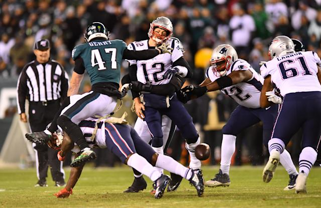 New England Patriots quarterback Tom Brady (12) is hit after spiking the ball under pressure against the Eagles. (Photo by Kyle Ross/Icon Sportswire via Getty Images)