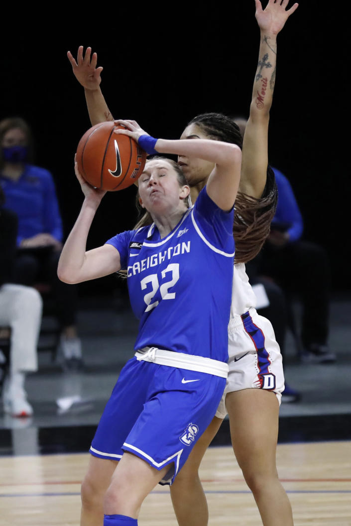 Creighton guard Carly Bachelor (22) is pressured by DePaul guard Sonya Morris during the first half of an NCAA college basketball game Saturday, Feb. 20, 2021, in Chicago. (AP Photo/Shafkat Anowar)