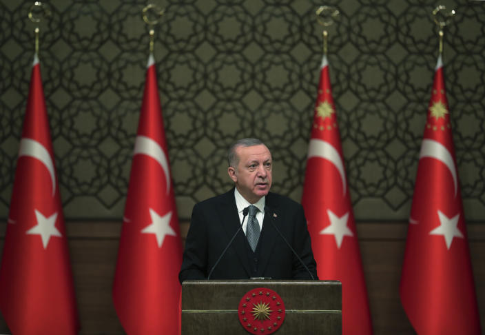 Turkey's President Recep Tayyip Erdogan deliver a speech at an event in Ankara, Turkey, Thursday, Jan. 2, 2020. Turkey's parliament on Thursday authorised the deployment of troops to Libya to support the U.N.-backed government in Tripoli battle forces loyal to a rival government that is seeking to capture the capital. Turkish lawmakers voted 325-184 at an emergency session in favour of a one-year mandate allowing the government to dispatch troops amid concerns that Turkish forces could aggravate the conflict in Libya and destabilise the region. (Presidential Press Service via AP, Pool)