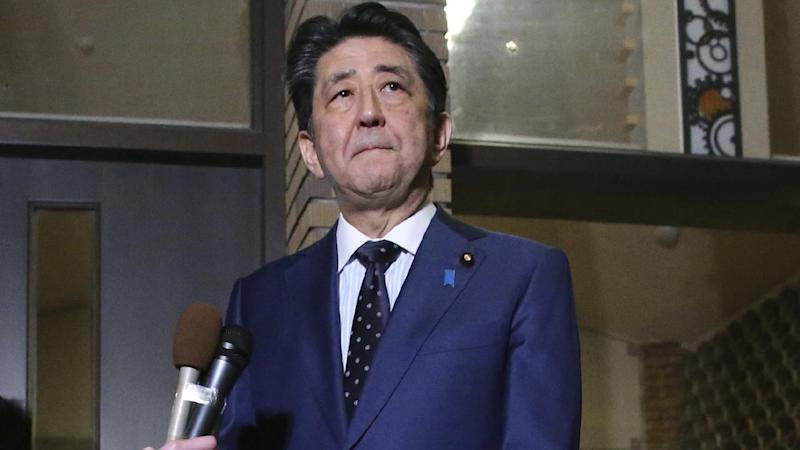 Japanese Prime Minister Shinzo Abe says the IOC president has agreed to postponing the Olympics