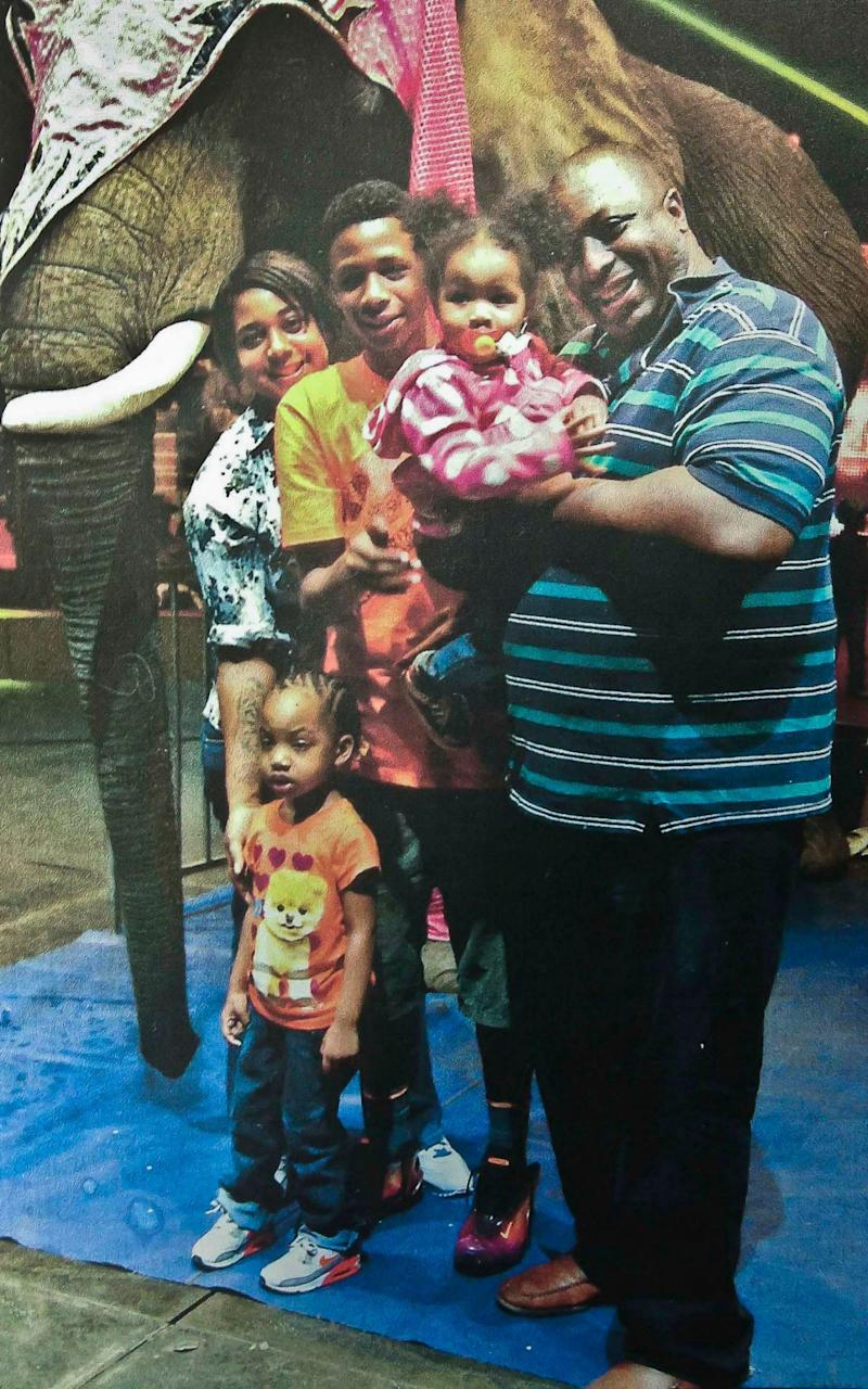 Eric Garner, right, poses with his children during a family outing - Family photo via National Action Network