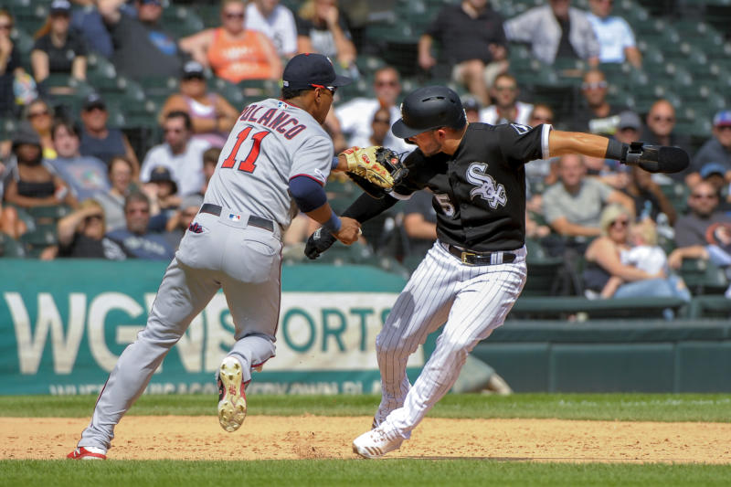 Minnesota Twins shortstop Jorge Polanco (11) catches up with Chicago White Sox's Yolmer Sanchez (5) during a rundown between second and third in the fifth inning of a baseball game Thursday, Aug. 29, 2019, in Chicago. (AP Photo/Mark Black)