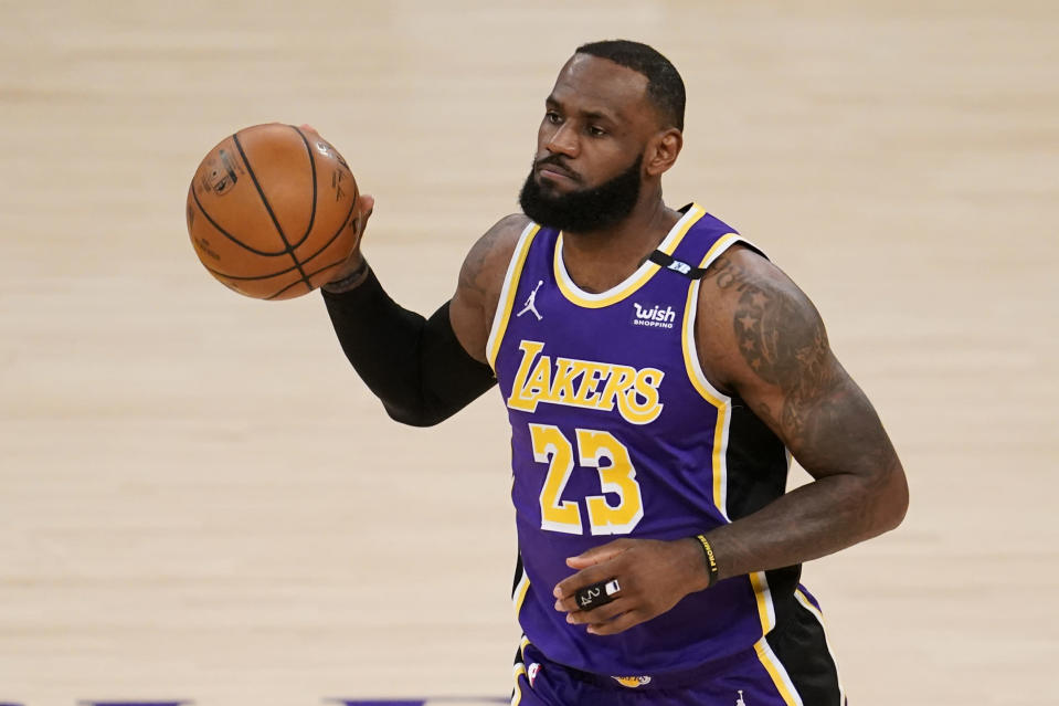 Los Angeles Lakers' LeBron James dribble the ball during the first half of the team's NBA basketball game against the Sacramento Kings on Friday, April 30, 2021, in Los Angeles. (AP Photo/Marcio Jose Sanchez)