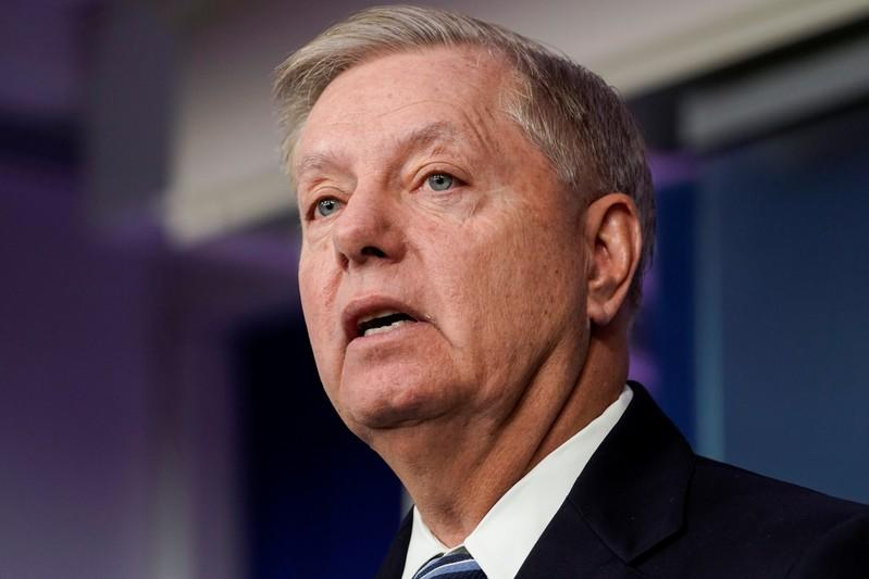 FILE PHOTO: Senator Lindsey Graham (R-SC) speaks after U.S. President Donald Trump announced that the Islamic State leader Abu Bakr al-Baghdadi was  believed to have been killed in a U.S. military operation inWashington