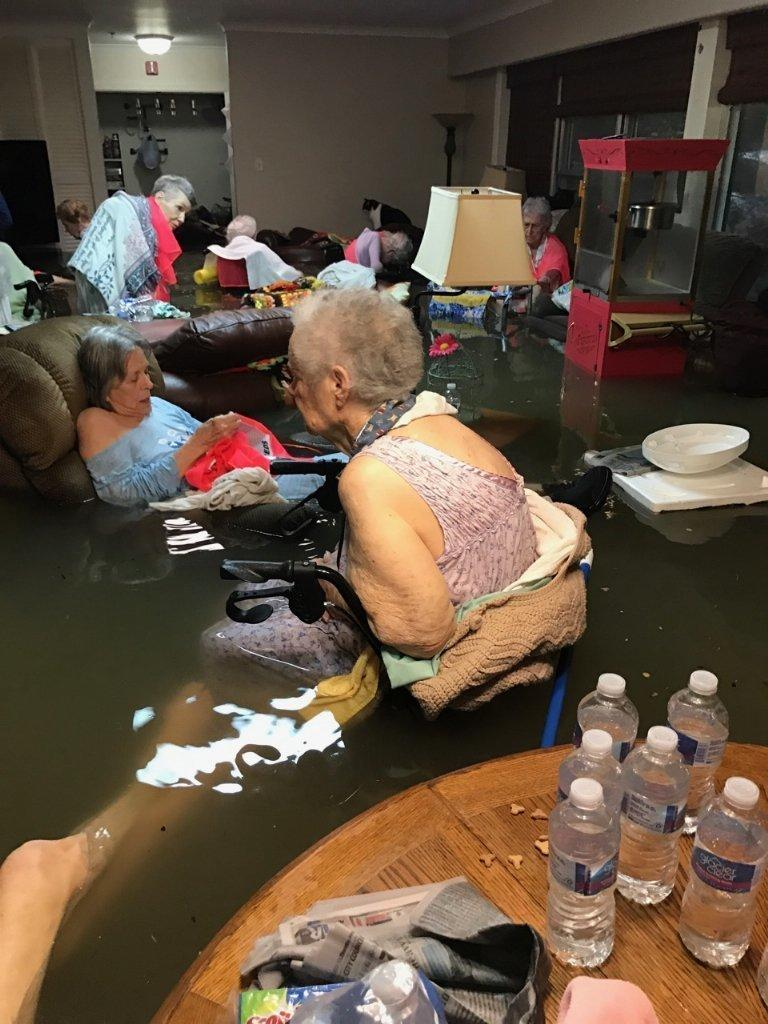 Residents of a flooded assisted living home in southeast Texas before their rescue on Sunday. (Timothy J. McIntosh)