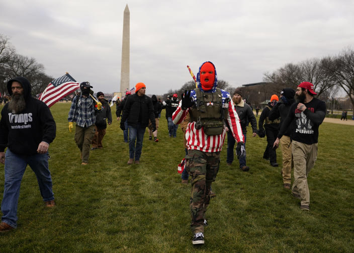People march with those who claim they are members of the Proud Boys as they attend a rally in Washington, Wednesday, Jan. 6, 2021, in support of President Donald Trump. (AP Photo/Carolyn Kaster)