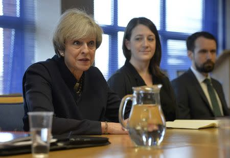 Britain's Prime Minister Theresa May talks with officers from Police Scotland at Govan Police Station, in Glasgow, Scotland