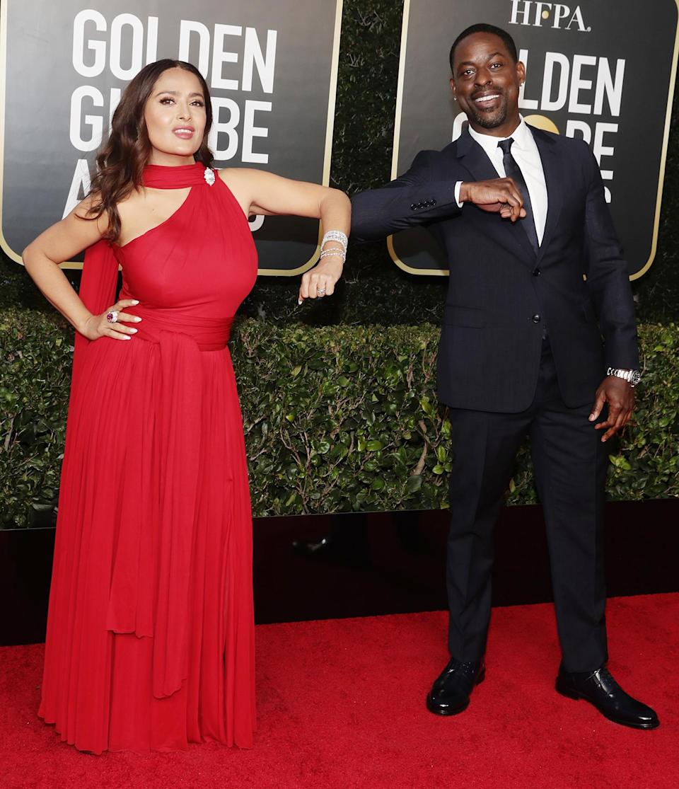 <p>Salma Hayek and Sterling K. Brown bump elbows on the Golden Globes red carpet on Sunday at The Beverly Hilton.</p>
