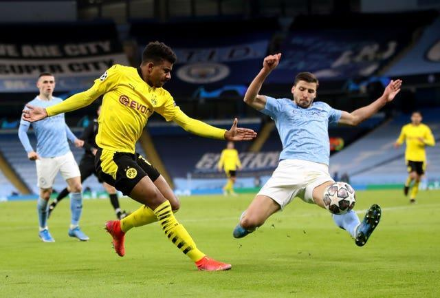 Dias (right) has been a commanding figure at the back for City