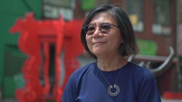 Amy Go, the president of the Chinese Canadian National Council for Social Justice, is one of many advocates seeking a heritage designation for Toronto's Chinatown. (CBC - image credit)