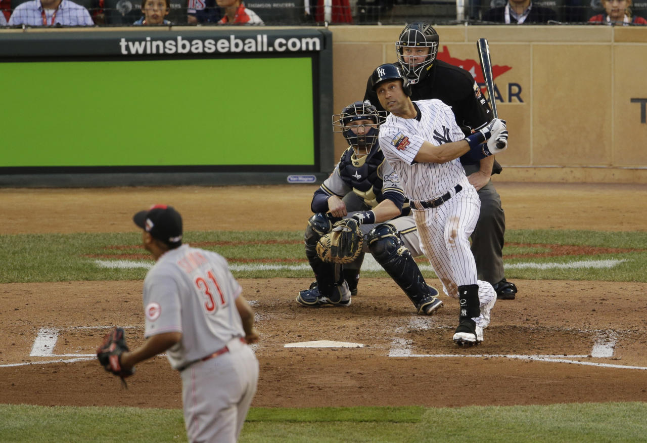 American League shortstop Derek Jeter, of the New York Yankees, singles during the third inning of the MLB All-Star baseball game, Tuesday, July 15, 2014, in Minneapolis. (AP Photo/Paul Sancya)