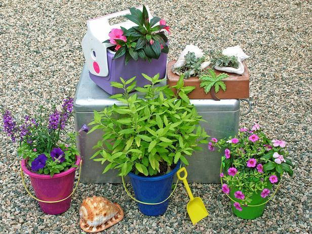 """<div class=""""caption-credit"""">Photo by: Nancy Ondra</div><div class=""""caption-title"""">At the Beach</div>Bring a bit of the seaside to your garden with a collection of beach-themed planters, such as inexpensive sand buckets or other plastic beach toys. Plastic and insulated metal coolers make great containers too. You can even fill large shells with sandy growing mix and tuck small succulents into them."""