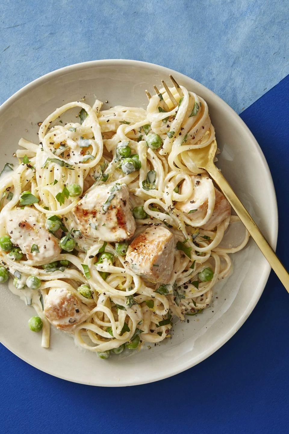 "<p>Liven up staples like chicken and linguine with a creamy tangy sauce of cream cheese and lemon.</p><p><em><a href=""https://www.goodhousekeeping.com/food-recipes/easy/a47534/creamy-lemon-chicken-pasta-recipe/"" rel=""nofollow noopener"" target=""_blank"" data-ylk=""slk:Get the recipe for Creamy Lemon Chicken Pasta »"" class=""link rapid-noclick-resp"">Get the recipe for Creamy Lemon Chicken Pasta »</a></em></p><p><strong>RELATED:</strong> <a href=""https://www.goodhousekeeping.com/food-recipes/easy/g2341/pasta-recipes-with-5-ingredients/"" rel=""nofollow noopener"" target=""_blank"" data-ylk=""slk:50+ Easy Pasta Recipes for the Perfect Weeknight Dinner"" class=""link rapid-noclick-resp"">50+ Easy Pasta Recipes for the Perfect Weeknight Dinner</a><br></p>"