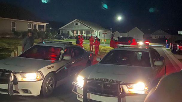 PHOTO: In this scene taken from video, police cars are shown outside the Shepard home on the night of the incident. (WWAY)