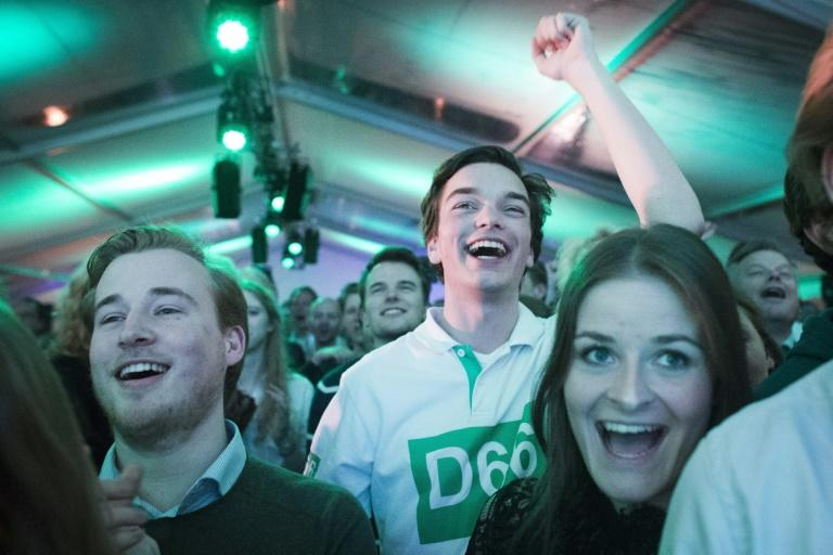 Militants of the Dutch Democracy party D66 celebrate during an election rally in Scheveningen, on March 15, 2017