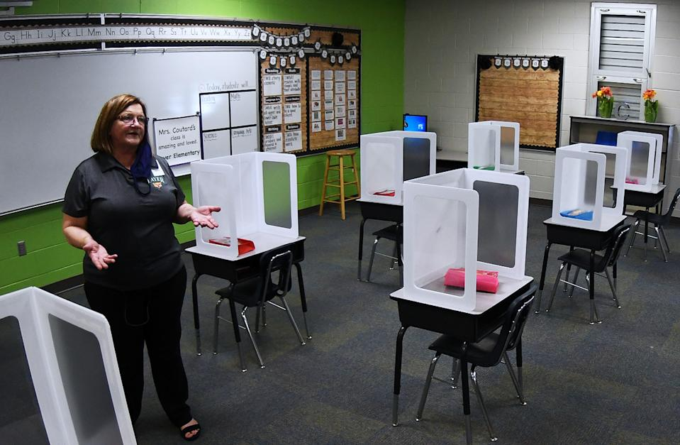 Cheryl Nicholas, Principal of Layer Elementary School, explains to the media the social distancing and other health precautions that have been initiated at the school a week before classes begin for the year during the COVID-19 pandemic on August 10, 2020 in Winter Springs, Florida. Classrooms will be limited to 15 students and desks fitted with shields will be appropriately spaced. (Photo by Paul Hennessy/NurPhoto via Getty Images)