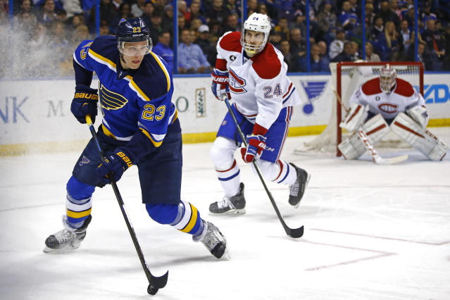 St. Louis Blues' Dmitrij Jaskin, left, of Russia, handles the puck as Montreal Canadiens' Jarred Tinordi, center and goalie Carey Price look on during the second period of an NHL hockey game Tuesday, Feb. 24, 2015, in St. Louis. (AP Photo/Billy Hurst)