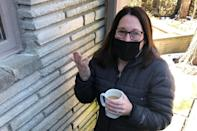 Cynthia Sbertoli talks about her experience going on unemployment Thursday, February 25, 2021, in Upper Arlington, Ohio. Sbertoli was receiving $228 a week after she was laid off in March from her job with a nonprofit. Her benefits were put on hold in January after she informed the state that someone had tried to use her identity in a scam to claim benefits. (AP Photo/Andrew Welsh-Huggins)