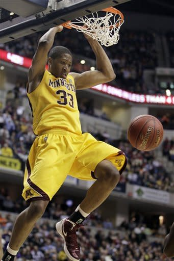 Minnesota forward Rodney Williams (33) dunks in the overtime of an NCAA college basketball game against Northwestern at the first round of the Big Ten Conference tournament in Indianapolis, Thursday, March 8, 2012. (AP Photo/Michael Conroy)