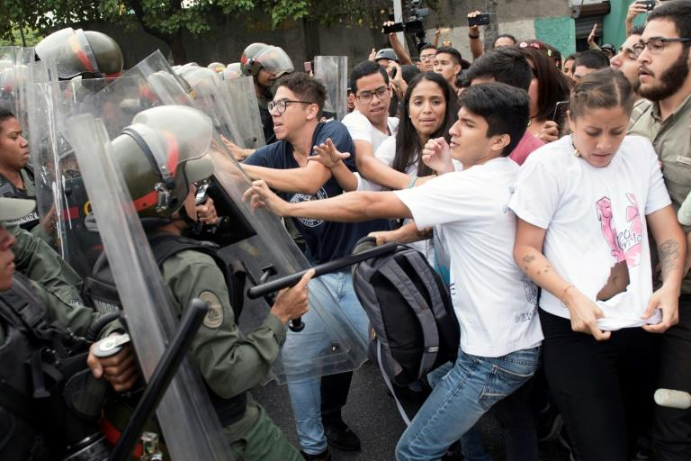Street protests erupted for a second day in Caracas as students marched on the Supreme Court, where they scuffled with soldiers