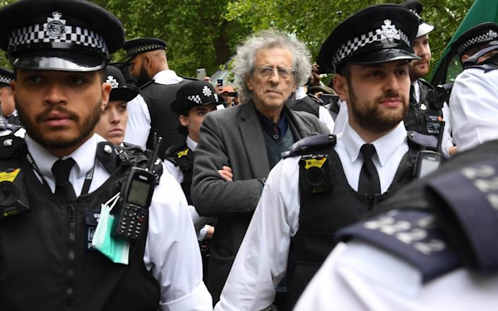 Police lead away Piers Corbyn as protesters gather in breach of lockdown rules in Hyde Park on May 16 - PA