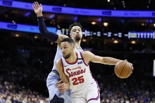 Philadelphia 76ers' Ben Simmons, front, dribbles past Memphis Grizzlies' Dillon Brooks during the first half of an NBA basketball game Friday, Feb. 7, 2020, in Philadelphia. (AP Photo/Matt Slocum)
