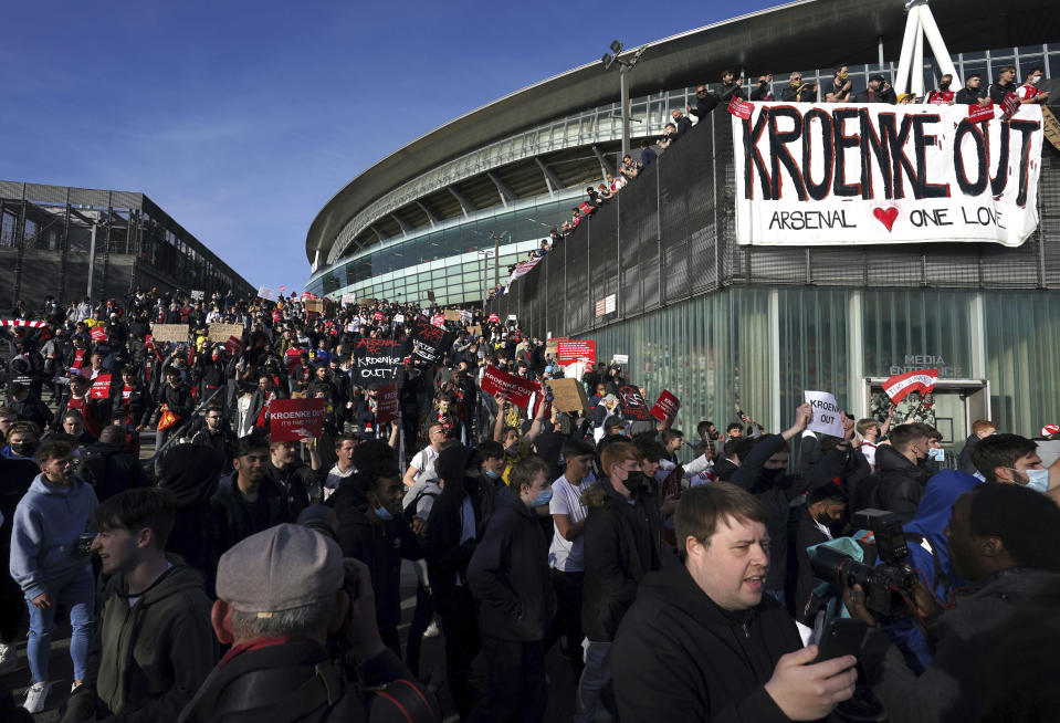 Fans protest against Arsenal owner Stan Kroenke before their English Premier League match against Everton, at the Emirates Stadium in London, Friday April 23, 2021. The fans want owner Stan Kroenke to leave the club over its bid to join the failed Super League. (John Walton/PA via AP)