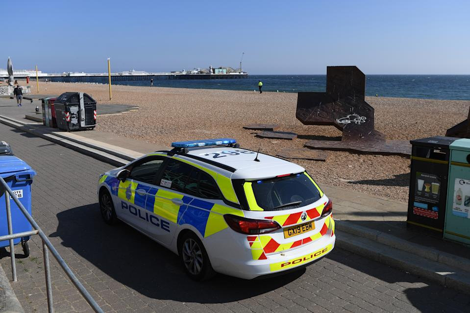 BRIGHTON, UNITED KINGDOM - APRIL 25: A police car patrols Brighton beach on April 25, 2020 in Brighton, United Kingdom. The British government has extended the lockdown restrictions first introduced on March 23 that are meant to slow the spread of COVID-19. (Photo by Mike Hewitt/Getty Images)