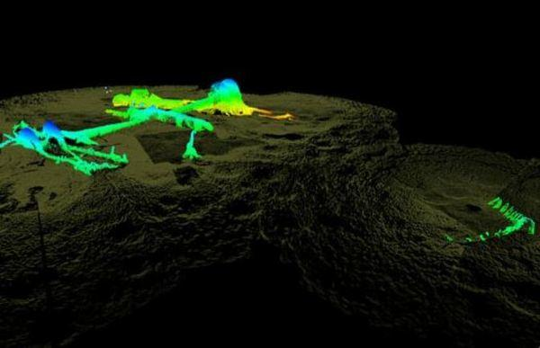 3D sonar view of the USS Hatteras from the vessel's port (left) side. More than half the hull lays buried in sediment. The curved tooth-like outline to the right is the remains of the stern and rudder.