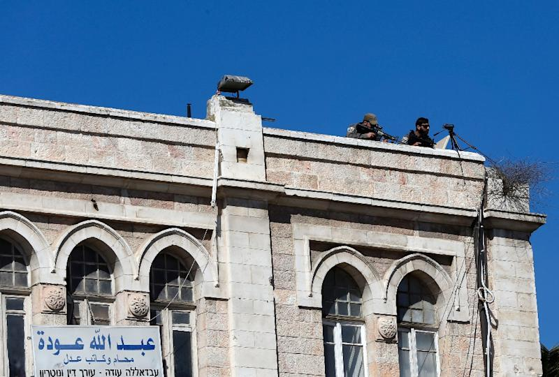 Snipers have positioned themselves on rooftops around Damascus Gate amid a wave of ongoing violence (AFP Photo/Ahmad Gharabli)