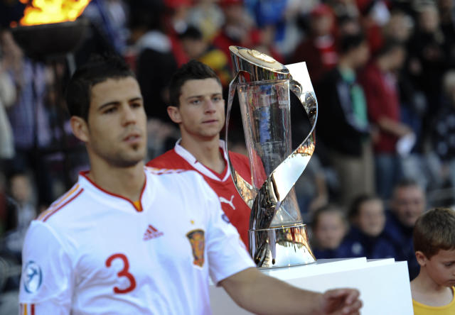 Alvaro Dominguez of Spain stands next to the trophy of the European Under-21 Championship the UEFA Under-21 European Championship final football match against Switzerland at NRGI Park Stadium in Arhus Stadion Denmark Saturday June 25, 2011. AFP PHOTO HENNING BAGGER SCANPIX (Photo credit should read HENNING BAGGER/AFP/Getty Images)