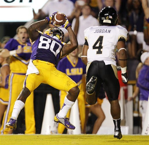 LSU wide receiver Jarvis Landry (80) catches a touchdown pass as Idaho cornerback Jayshawn Jordan (4) covers in the first half of their NCAA college football game in Baton Rouge, Saturday, Sept. 15, 2012. (AP Photo/Gerald Herbert)