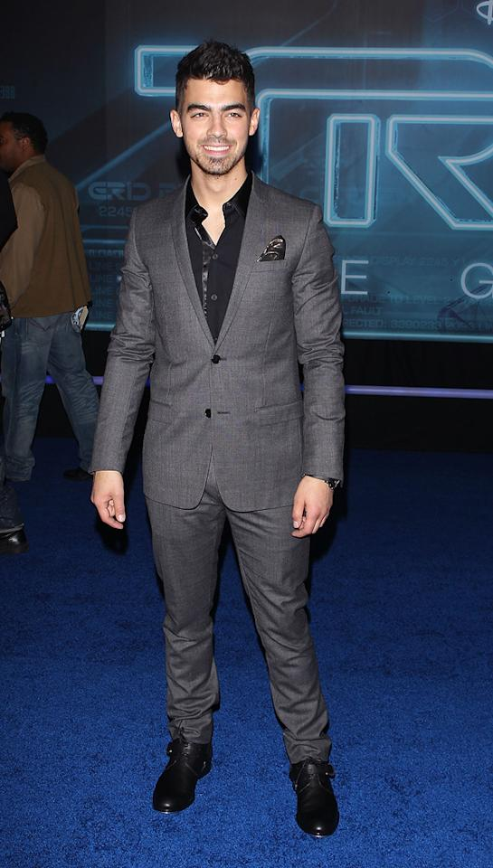 """<a href=""""http://movies.yahoo.com/movie/contributor/1809692473"""">Joe Jonas</a> attends the Los Angeles premiere of <a href=""""http://movies.yahoo.com/movie/1810096458/info"""">TRON: Legacy</a> on December 11, 2010."""
