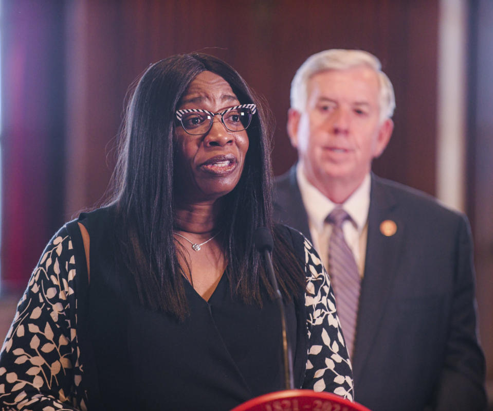 Missouri Gov. Mike Parson looks on as the newest member of the Missouri Supreme Court, Judge Robin Ransom, addresses the media after being introduced by Parson during a press conference Monday, May 24, 2021, at his Capitol office in Jefferson City, Mo. Ransom was selected from 25 applicants for the position. (Julie Smith/The Jefferson City News-Tribune via AP)