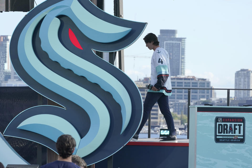 Hadyn Fluery, a defenseman from the Anaheim Ducks, walks off stage after being introduced as a new player with the Seattle Kraken NHL hockey team, Wednesday, July 21, 2021, during the Kraken's expansion draft event in Seattle. (AP Photo/Ted S. Warren)
