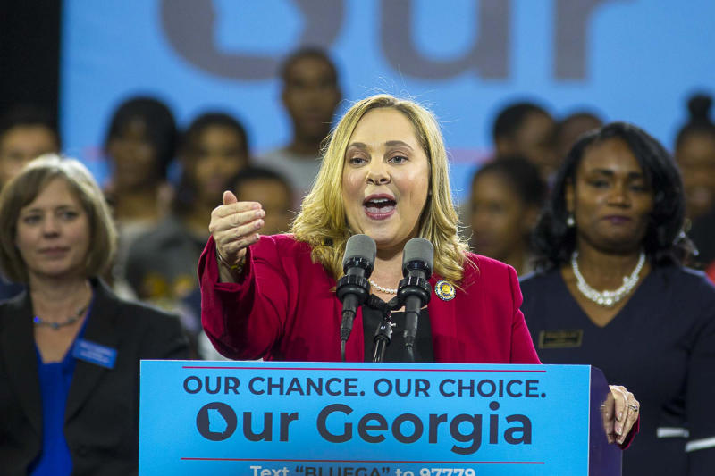 FILE - In a Friday, Nov. 2, 2018 file photo, Sarah Riggs Amico speaks during a rally for Democratic gubernatorial candidate Stacey Abrams in Atlanta. Top Democrats in Georgia's Senate primary include former congressional candidate Jon Ossoff; former Columbus Mayor Teresa Tomlinson; and Amico. (Alyssa Pointer/Atlanta Journal-Constitution via AP, File)