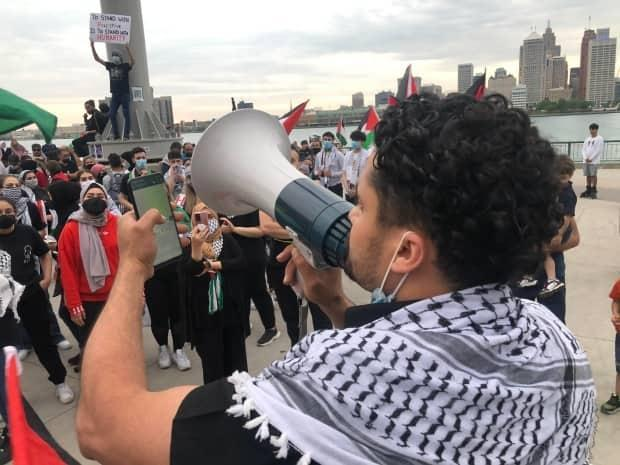 Palestinian supporters gathered for a demonstration along Windsor's riverfront on Wednesday evening. (Jacob Barker/CBC - image credit)