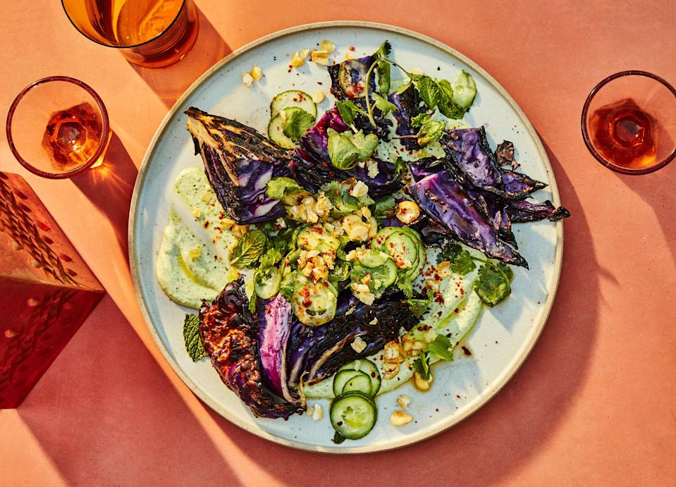 "For this vegetarian grilling recipe, go hard when charring the cabbage wedges—to the point you might think you did something wrong. They are dense and resilient and need a long time on the grill to soften. Serve this summer side dish with a refreshing raita sauce and crunchy Corn Nuts on top, and prepare to be amazed. <a href=""https://www.bonappetit.com/recipe/charred-cabbage-with-goat-cheese-raita-and-cucumbers?mbid=synd_yahoo_rss"" rel=""nofollow noopener"" target=""_blank"" data-ylk=""slk:See recipe."" class=""link rapid-noclick-resp"">See recipe.</a>"