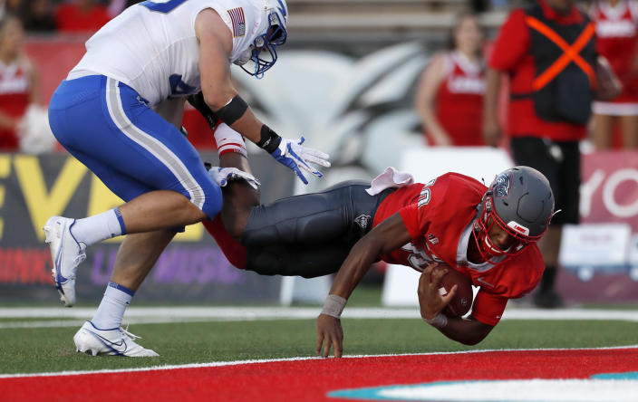 New Mexico quarterback Trae Hall (10) lunges for the goal line to score a touchdown against Air Force inside linebacker Alec Mock, left, during the second half of an NCAA college football game on Saturday, Oct. 2, 2021, in Albuquerque, N.M. Air Force won 38-10. (AP Photo/Andres Leighton)